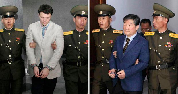 U.S. citizens Otto Warmbier, left, and Kim Dong Chul are escorted by Military police in Pyongyang, North Korea. North Korea has detained U.S. citizen, Tony Kim, who also goes by his Korean name Kim Sang-duk. He is the third US citizen to be held by the regime since 2016. Photo: AP
