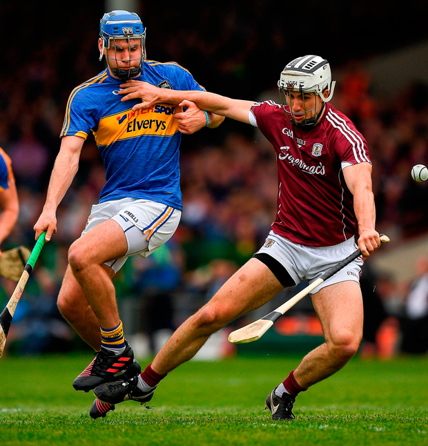 Galway's Aidan Harte in action against John McGrath of Tipperary. Photo: Ray McManus/Sportsfile