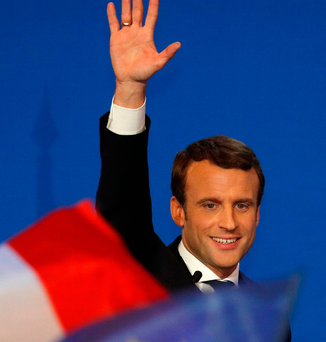 Emmanuel Macron salutes supporters after he delivered a speech at the Parc des Expositions hall in Paris. Photo: Reuters