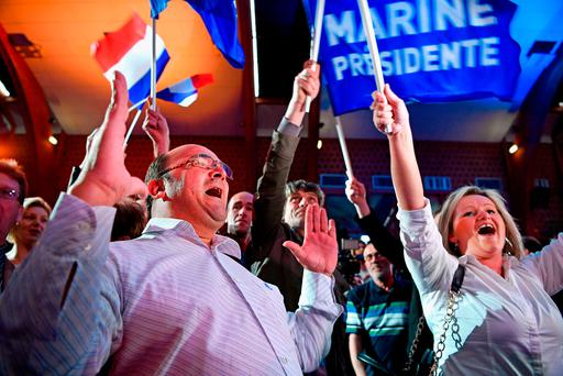 Supporters of National Front leader Marine Le Pen celebrate in the Francois Mitterrand centre in Henin Beaumont. Photo: Getty