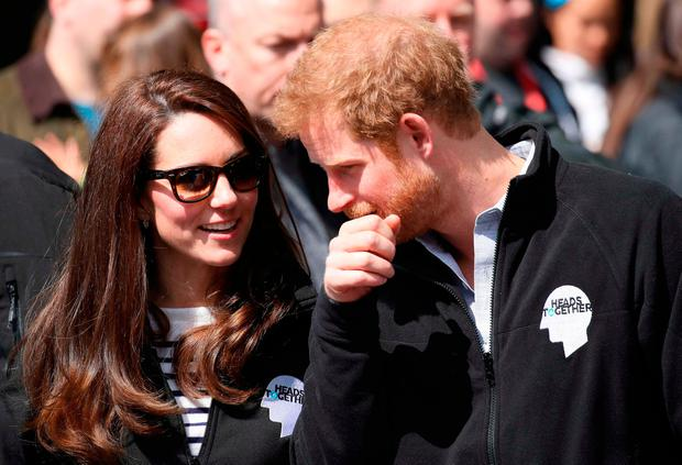 Britain's Catherine, Duchess of Cambridge and Britain's Prince Harry cheer and hand out water to runners during the 2017 London Marathon in London on April 23, 2017. / AFP PHOTO / POOL / Chris JacksonCHRIS JACKSON/AFP/Getty Images