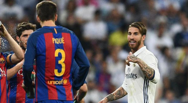 Sergio Ramos was shown a red card during el clasico and remonstrated with Gerard Pique as he left the field. Getty