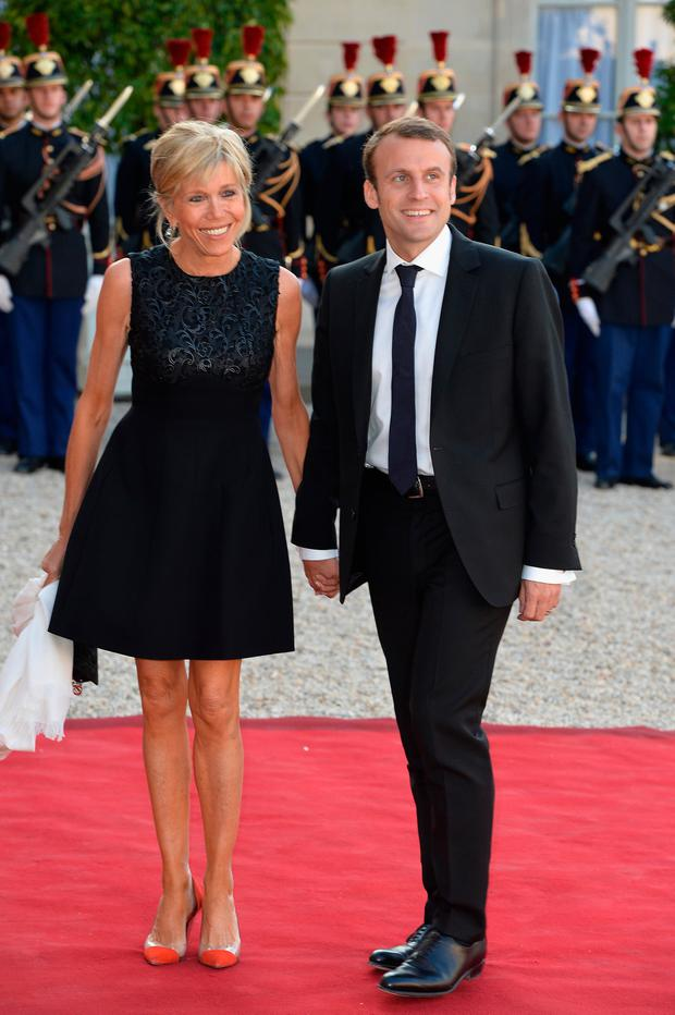 French Minister of Economy Emmanuel Macron (R) and wife arrive for the State Dinner Offered By French President Fran?ois Hollande at the Elysee Palace on June 2, 2015 in Paris, France. (Photo by Pascal Le Segretain/Getty Images)