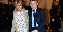 French Economy Minister Emmanuel Macron (R) and his wife Brigitte Trogneux arrive for a state dinner in honor of King Willem and Queen Maxima of The Netherlands at the Elysee Palace in Paris on March 10, 2016. AFP PHOTO / BERTRAND GUAY / AFP / BERTRAND GUAY (Photo credit should read BERTRAND GUAY/AFP/Getty Images)