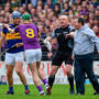 16 April 2017; Wexford manager Davy Fitzgerald and Aidan Nolan, 8, tussle with Jason Forde of Tipperary during the Allianz Hurling League Division 1 Semi-Final match between Wexford and Tipperary at Nowlan Park in Kilkenny. Photo by Ramsey Cardy/Sportsfile