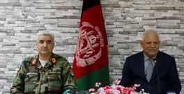 Afghanistan's Defense Minister Abdullah Habibi (R) and Army Chief of Staff Qadam Shah Shahim attend a news conference after their resignation