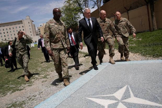 U.S. Defense Secretary James Mattis (3rd R) is greeted by U.S. Army Command Sergeant Major David Clark (L) and General Christopher Haas (2nd R) as he arrives at Resolute Support headquarters in Kabul