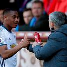 Manchester United's Anthony Martial is congratulated by manager Jose Mourinho after he is substituted yesterday