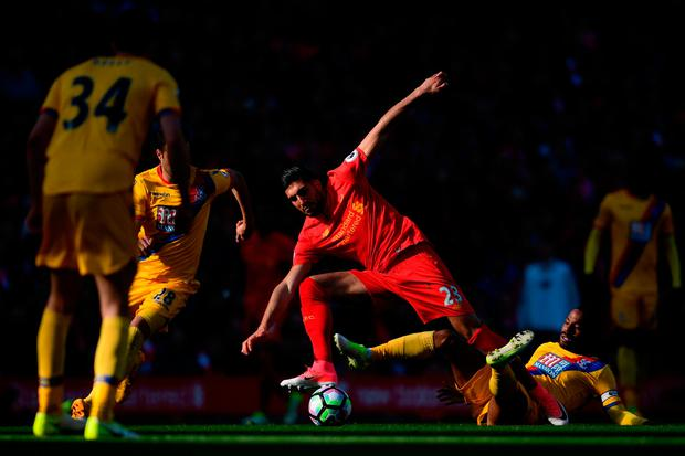 Emre Can of Liverpool is tackled by Jason Puncheon of Crystal Palace during the Premier League match between Liverpool and Crystal Palace at Anfield