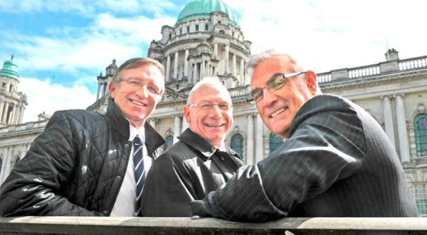 L-R, David Irwin, Nigel Carr and Philip Rainey re-united at Belfast City Hall. Credit: Alan Lewis