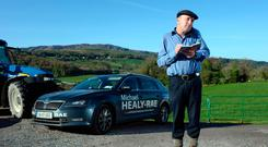 Michael Healy-Rae TD pictured on a farm in South Kerry dealing with constituency matters. Photo: Don MacMonagle