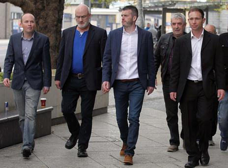 From the left: Paul Murphy, Michael Murphy, Scott Masterson, Frank Donaghy and Kieran Mahon arrive at court. Photo: Collins