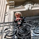 French far-right leader and candidate for the 2017 presidential election Marine Le Pen appears on the balcony of her campaign headquarters in Paris