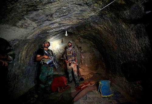 Afghan Special Forces inspect a cave which was used by suspected Isil militants at the site where a MOAB, or 'Mother of All Bombs', struck the Achin district of the eastern province of Nangarhar, Afghanistan. Photos: Parwiz/Reuters