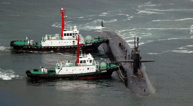 The nuclear-powered submarine USS Michigan approaches to join the U.S. aircraft carrier USS Carl Vinson in drills near the Korean Peninsula, at Busan port in Busan, South Korea (Jo Jung-ho/Yonhap via AP)