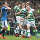 Stuart Armstrong of Celtic (CL) celebrates scoring his sides first goal with James Forrest of Celtic (CR) and the rest of his Celtic team mates during the Ladbrokes Scottish Premiership match between Celtic and Rangers at Celtic Park on March 12, 2017 in Glasgow, Scotland. (Photo by Ian MacNicol/Getty Images)