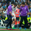 An injured Gareth Bale of Real Madrid leaves the pitch during the La Liga match between Real Madrid CF and FC Barcelona at Estadio Bernabeu on April 23, 2017 in Madrid, Spain. (Photo by Gonzalo Arroyo Moreno/Getty Images)
