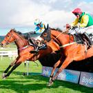 Jockey Robbie Power on board Fox Norton (nearside) wins the BoyleSports Champion Chase during day one of the Punchestown Festival