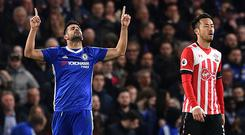 Chelsea's Brazilian-born Spanish striker Diego Costa celebrates after scoring their third goal during the English Premier League football match between Chelsea and Southampton at Stamford Bridge in London on April 25, 2017. / AFP PHOTO / Glyn KIRK