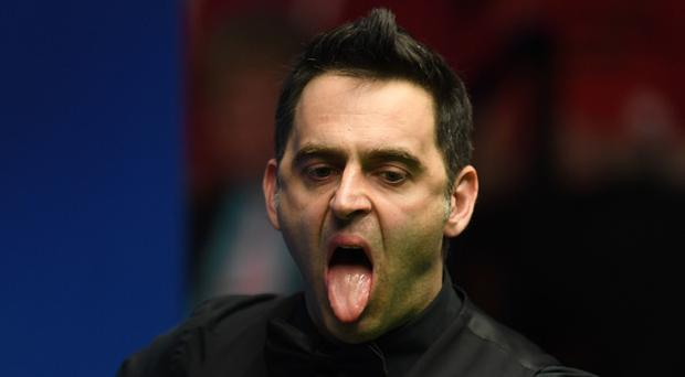England's Ronnie O'Sullivan gestures during the World Championship Snooker quarter-final against China's Ding Junhui at The Crucible in Sheffield, northern England on April 25, 2017. / AFP PHOTO / PAUL ELLIS
