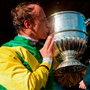Jockey Robbie Power celebrates with the trophy after winning the BoyleSports Champion Chase on Fox Norton at Punchestown yesterday. Photo by Cody Glenn/Sportsfile