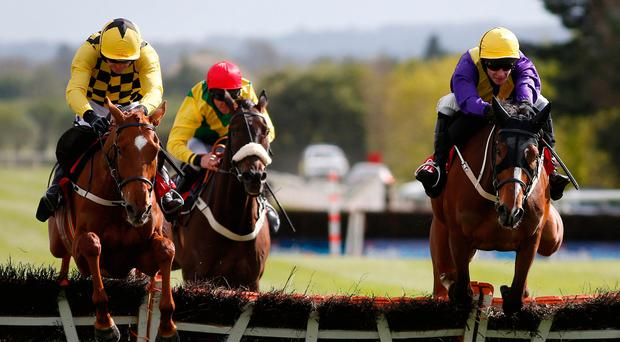 Cilaos Emery (right), with David Mullins on board, clears the last on the way to winning The Herald Champion Novice Hurdle from Melon (left), partnered by Ruby Walsh, at Punchestown. Photo: Alan Crowhurst/Getty Images