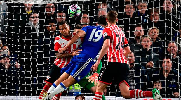 Diego Costa holds off the challenge of Southampton defender Ryan Bertrand to score Chelsea's third goal last night Photo: GLYN KIRK/AFP/Getty Images