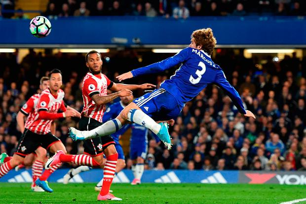 Chelsea defender Marcos Alonso (right) fails to score with this acrobatic attempt Photo: GLYN KIRK/AFP/Getty Images