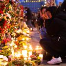 Two women mourn the victims of the Stockholm lorry attack earlier this month Picture: AP