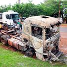 A truck burned near the headquarters of private security company Prosegur is pictured in Ciudad del Este, eastern Paraguay, after a group of dozens of people carried out an assault with explosives at the site. Photo: Reuters/Francisco Espinola