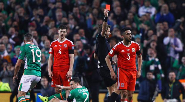 DUBLIN, IRELAND - MARCH 24: Players react as Neil Taylor of Wales (3) is shown a red card by referee Nicola Rizzoli and is sent off after a challenge on Seamus Coleman of the Republic of Ireland (2) during the FIFA 2018 World Cup Qualifier between Republic of Ireland and Wales at Aviva Stadium on March 24, 2017 in Dublin, Ireland. (Photo by Ian Walton/Getty Images)