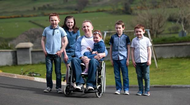 John McNaughton from Glenariff with his kids, Shannon (3), Shea (13), Clodagh (11), Eoin (8) and Ruairi (6). Photo: Belfast Telegraph