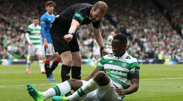 GLASGOW, SCOTLAND - APRIL 23: Moussa Dembele of Celtic lies injured during the Scottish Cup Semi-Final match between Celtic and Rangers at Hampden Park on April 23, 2017 in Glasgow, Scotland. (Photo by Ian MacNicol/Getty Images)