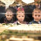 Devin Kennedy Kiely (13) and sister Ella Kennedy Kiely (9) with brother Daryl Kennedy Kiely (6) pictured looking at a model of the new hospital (Pic: Colin O'Riordan)