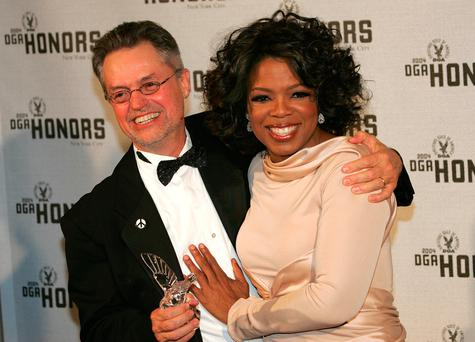 Director Jonathan Demme poses with television personality Oprah Winfrey backstage at the 5th Annual Directors Guild Of America Honors at the Waldorf Astoria Hotel September 29, 2004 in New York City. Photo: Evan Agostini/Getty Images