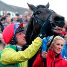 Jockey Robbie Power and Sizing John celebrate winning the Coral Punchestown Gold Cup during day two of the Punchestown Festival
