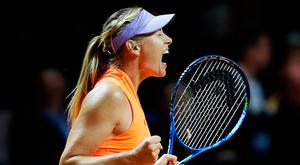 Russia's Maria Sharapova reacts after winning 7-5, 6-3 against Italy's Roberta Vinci at the Porsche Tennis Grand Prix in Stuttgart