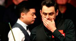 Ronnie O'Sullivan reacts after a missed shot against Ding Junhui. Photo: PA Wire