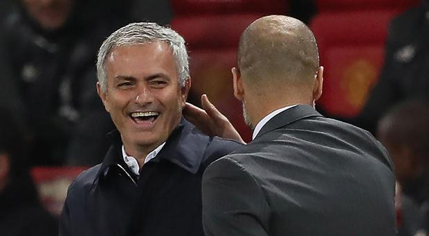 Old rivals Jose Mourinho and Pep Guardiola lock horns again in tonight's Manchester derby. Photo: Matthew Ashton/AMA