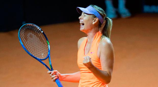 Maria Sharapova reacting to her victory over Italy's Roberta Vinci. Photo: Getty