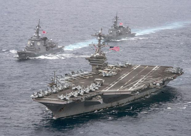The USS Carl Vinson leads two destroyers during a transit of the Philippine Sea yesterday. Photo: U.S. Navy Photographer