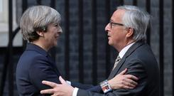 Britain's Prime Minister Theresa May welcomes Head of the European Commission Jean-Claude Juncker to Downing Street. Photo: Carl Court/Getty Images