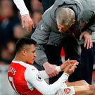 Arsene Wenger with Sanchez and (inset) the Arsenal man shared a picture of his 'injury' after the win over Leicester