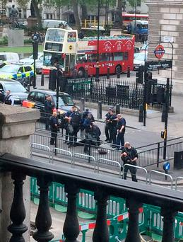 Police at the scene where a man has been arrested following an incident in Whitehall in London (PA/Twitter feed of @joshdcaplan)