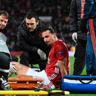 Manchester United's Swedish striker Zlatan Ibrahimovic gets treatment after injuring his knee during the UEFA Europa League quarter-final second leg football match between Manchester United and Anderlecht at Old Trafford in Manchester, north west England, on April 20, 2017. / AFP PHOTO / Oli SCARFF