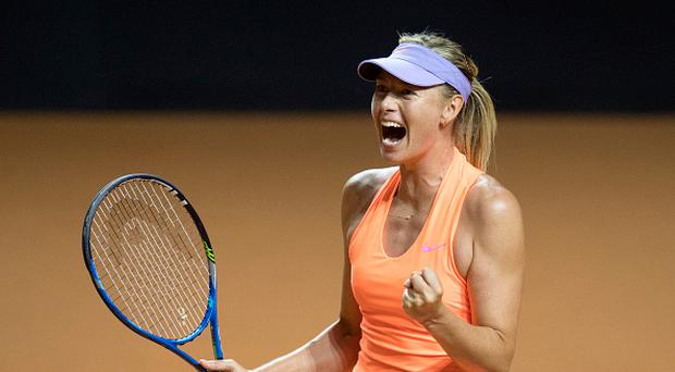 Russia's Maria Sharapova celebrates after she defeated Russia's Ekaterina Makarova in their second round match at the WTA Porsche Tennis Grand Prix in Stuttgart, southwestern Germany, on April 27, 2017. / AFP PHOTO / THOMAS KIENZLE
