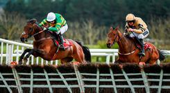 Unowhatimeanharry, left, with Noel Fehily up, jump the last alongside Nichols Canyon, with Ruby Walsh up, who finished second, on their way to winning the Ladbrokes Champion Stayers Hurdle at Punchestown Racecourse in Naas, Co. Kildare. Photo by Seb Daly/Sportsfile