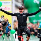 Swiss Stefan Kung celebrates after winning the second stage of the