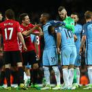 MANCHESTER, ENGLAND - APRIL 27: Andre Herrera of Manchester United and Fernandinho of Manchester City disagree during the Premier League match between Manchester City and Manchester United at Etihad Stadium on April 27, 2017 in Manchester, England. (Photo by Robbie Jay Barratt - AMA/Getty Images)