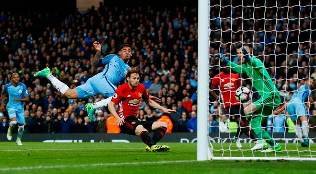 Gabriel Jesus puts the ball in the net for Manchester City before the goal was ruled out for offside. Photo: REUTERS